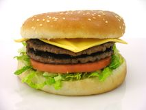 Double cheese burger. Tasty double cheese burger right out from the grill Stock Image