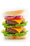Double Cheese Burger. Double cheeseburger isolated over white royalty free stock photo