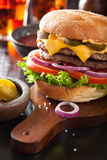 Double cheese burger with jalapeno tomato onion Royalty Free Stock Images