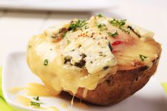 Double cheese twice baked potato. Sprinkled with parsley Royalty Free Stock Photography