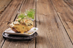 Double cheese twice baked potato. Sprinkled with parsley Stock Image