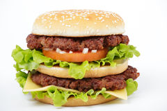 Double cheeseburger. Isolated on white background royalty free stock image