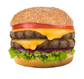 Double Cheeseburger. Double Burger Cheeseburger with Lettuce Tomato American Cheese and Onion Ring royalty free stock photography