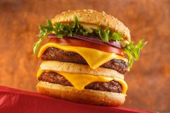 Double cheeseburger. Classic double cheeseburger with two grilled beef patties royalty free stock photo