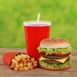 Double Cheeseburger combo meal with french fries and cola Stock Photography