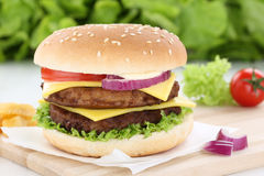 Double cheeseburger hamburger beef onion tomatoes lettuce cheese Stock Images