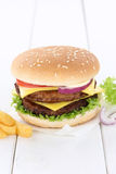 Double cheeseburger hamburger copyspace copy space beef tomatoes Stock Photography
