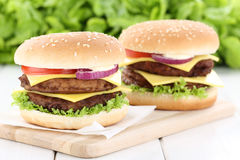 Double cheeseburger hamburger fresh beef tomatoes lettuce cheese Stock Image