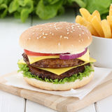Double cheeseburger hamburger and fries beef tomatoes lettuce ch Stock Images