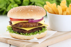 Double cheeseburger hamburger with fries Stock Images