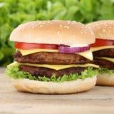 Double cheeseburger hamburger tomatoes cheese Stock Photography