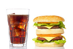 Double cheeseburger and soda glass. Reflected on white background royalty free stock photos