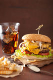 Double cheeseburger with tomato and onion Royalty Free Stock Photos