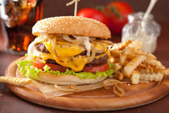 Double cheeseburger with tomato and onion Stock Photography