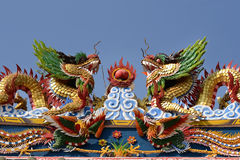 Double Chinese dragon on the temple roof. Royalty Free Stock Images