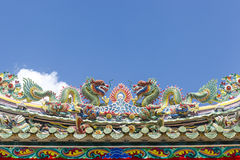 The Double Chinese dragon on the temple roof Stock Photo