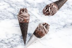 Double Chocolate Ice Creams with Black Waffle Cones stock images