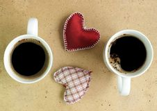Double coffee. Two cups of black coffee with hearts Stock Image