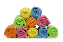 Double color towels curtailed into a roll Stock Photos