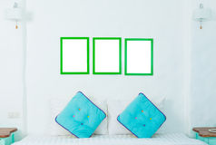 Double colorful pillow in the bedroom with photo frame Stock Photography