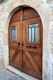 A double dark wooden door. Royalty Free Stock Photography