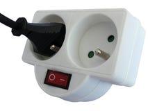 Double de robinet de débouché avec la prise insérée Photos stock