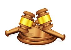 A Double Decision. Two judge's gavel mallet lying crossed over each other, to signify either conflict or common decision Royalty Free Stock Photos