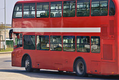 Double deck bus. Closeup of a red double deck bus on the intersection Royalty Free Stock Photos