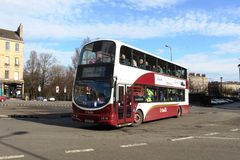 Double deck bus in Lothian livery in Edinburgh. Modern double deck bus operated by Lothian busses on a service 25 to Riccarton approaching the centre of Royalty Free Stock Images