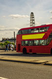 Double deck red bus on the bridge in London, symbolic vehicle on. The bridge, London, sunny day Stock Photography