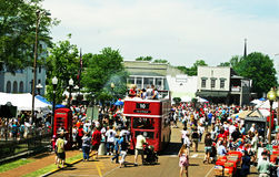 Double Decker. Bus rides are a big hit at the  Festival. About 55,000 people gathered in the streets of Oxford, Mississippi on Saturday,April 25,2009. This Stock Photo