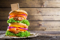 Double-decker burger on wooden background with space to menu Stock Photo