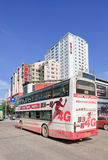 Double decker bus with advertising, Kunming, China. KUNMING-JUNE 30, 2014. Double decker with advertisement. China's outdoor advertising market has grown Stock Photo