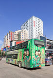 Double decker bus with advertising, Kunming, China. KUNMING-JUNE 30, 2014. Double decker with advertisement. China's outdoor advertising market has grown Stock Photography