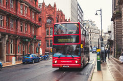 Double-decker bus in Birmingham, UK. BIRMINGHAM, UK - SEPTEMBER 1, 2014: Red double-decker bus at the street. Old building of the historical part of the city Royalty Free Stock Image