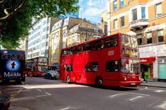 Double-decker bus at the center of London. Double-decker buses in the central London at morning time. UK Stock Photos