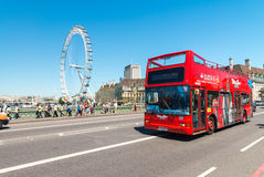 Double Decker bus crossing city streets. I. LONDON - MAY 5, 2015: Double Decker bus crossing city streets. It is a city attraction for worldwide tourists Stock Image