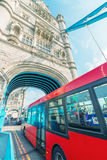 Double Decker bus crossing crowded Tower Bridge - London Stock Images
