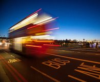 Double-Decker bus crossing Westminster Bridge at night. A Double-Decker bus crossing Westminster Bridge at dusk royalty free stock images