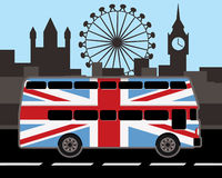 Double decker bus in great britain flag color. Double decker bus in red and great britain flag color, london sights in background Stock Photo