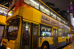 Double decker bus in Hong Kong night. HONG KONG - SEPTEMBER 30, 2011: City double decker bus on the streets of Hong Kong night. Bus mode of transport is very Royalty Free Stock Images