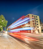Double Decker bus light trails in London streets.  Royalty Free Stock Photos