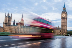 Double-decker bus in London. A double decker bus crosses Westminster Bridge in London Stock Photography
