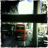 Double decker bus in London - Mobile. A double Decker bus leaves the bus stop in a trafficked street of London. Shot with mobile phone Stock Images