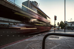Double decker bus on London street. Red double decker bus driving on street with motion blue, London, England Stock Photography