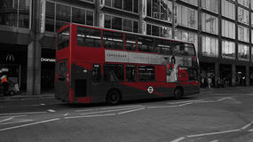Double decker bus in London, UK. A photo of a double decker bus in London using a red partial color effect. First introduced in 1829, and was still called an Royalty Free Stock Photos