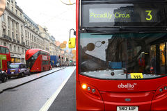 Double-decker bus in London. London, United Kingdom - January 2016: a modern double-decker bus in Regent Street. Some people are visible in the street. Double Stock Images