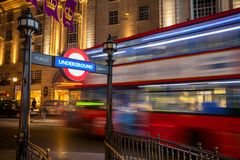 Double Decker bus moves along the Regent Street in London UK. Double Decker bus moves along the Regent Street at night near the Piccadilly Circus underground Stock Image