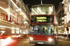 Double Decker Bus at Night. Double Decker Bus, most iconic symbol of London, in Oxford Street at Night Stock Photography