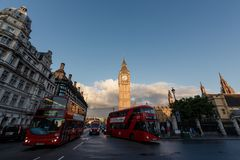 Double-decker bus passes pedestrians walking in front of Big Ben Royalty Free Stock Images